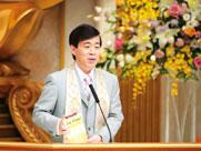 Master Okawa presenting a book